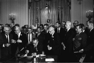 800px-Lyndon_Johnson_signing_Civil_Rights_Act,_July_2,_1964