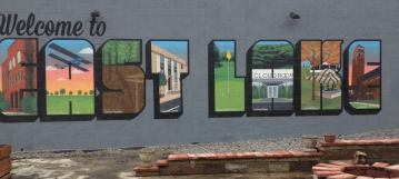 "East Lake mural located at the East 59 Vintage and Cafe that pays homage to the heritage of East Lake. ""Old Main"" from Howard College appears in the first ""E"" while the Cloud Room is depicted in the second ""A."""